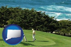 connecticut map icon and two golfers on the green at an oceanside golf course