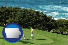 iowa map icon and two golfers on the green at an oceanside golf course