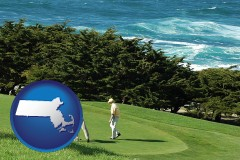 massachusetts map icon and two golfers on the green at an oceanside golf course
