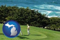 michigan map icon and two golfers on the green at an oceanside golf course
