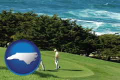 north-carolina map icon and two golfers on the green at an oceanside golf course