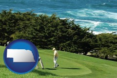 nebraska map icon and two golfers on the green at an oceanside golf course