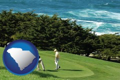 south-carolina map icon and two golfers on the green at an oceanside golf course