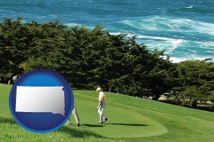 south-dakota map icon and two golfers on the green at an oceanside golf course