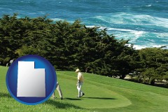 utah map icon and two golfers on the green at an oceanside golf course