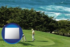 wyoming map icon and two golfers on the green at an oceanside golf course
