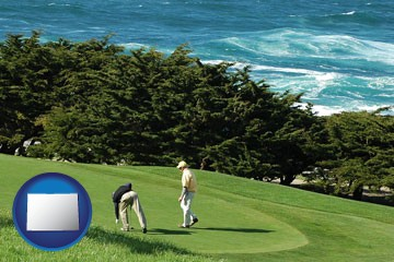 two golfers on the green at an oceanside golf course - with Colorado icon