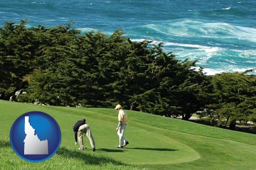 two golfers on the green at an oceanside golf course - with Idaho icon