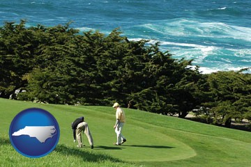 two golfers on the green at an oceanside golf course - with North Carolina icon