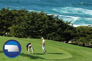 two golfers on the green at an oceanside golf course - with Nebraska icon